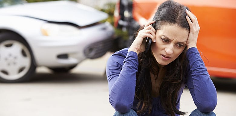 woman on phone after car accident