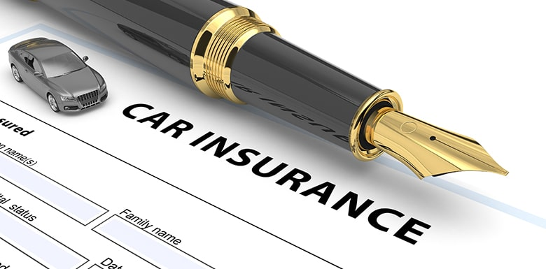 Car insurance form with a pen and toy car