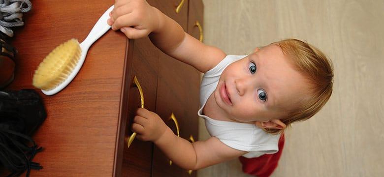 Child climbing on unanchored furniture