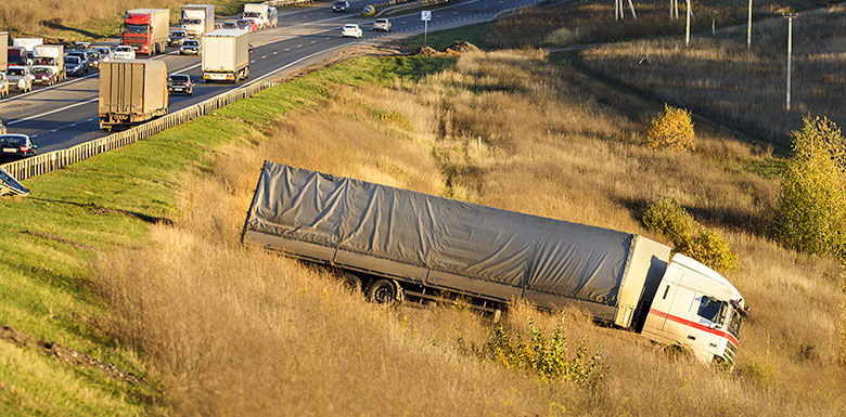 large truck accident in ditch