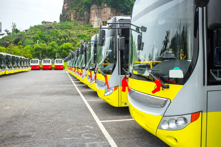 A large number of new electric buses parked in the parking lot