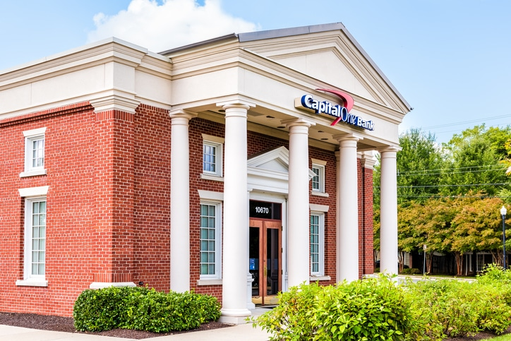 Capital One bank branch entrance with sign and columns in old town in Northern Virginia with brick facade