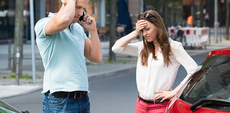people on phone after accident