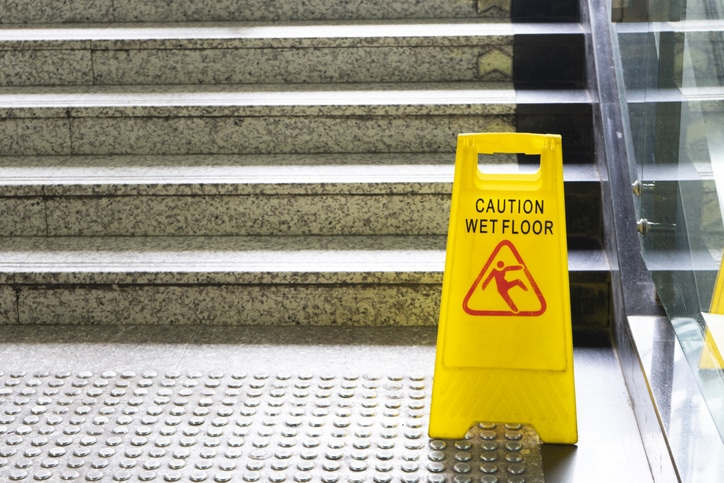 wet floor sign on stairs