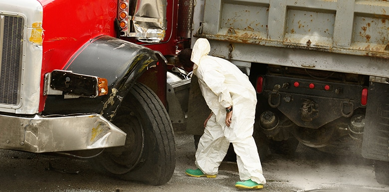 Man inspecting truck after accident