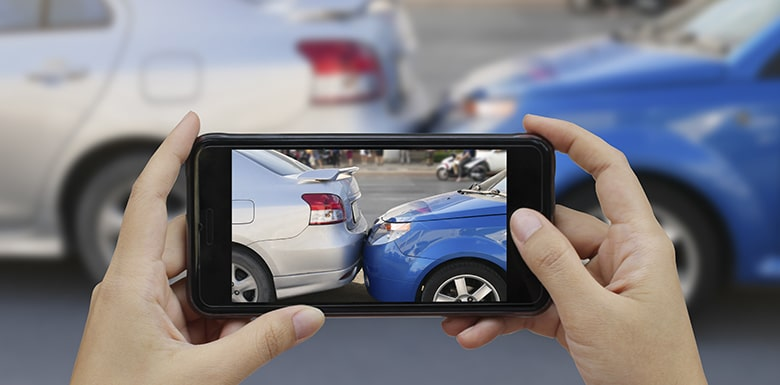 taking picture of car accident on phone