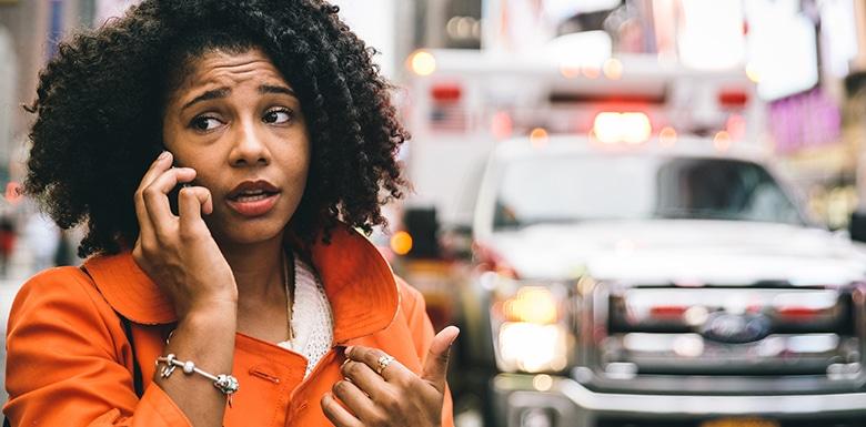woman on phone after a car accident