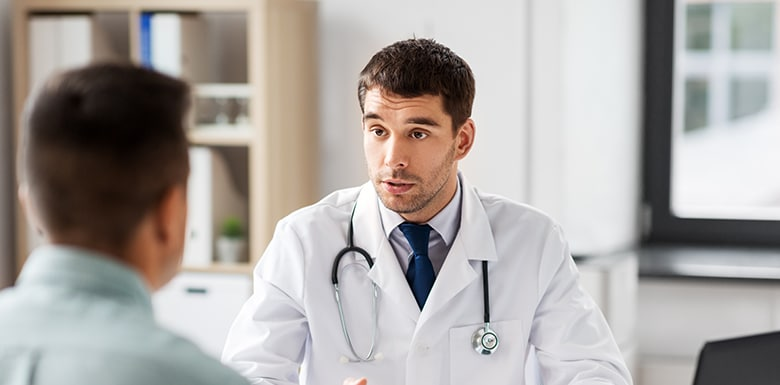 Doctor talking to his patient image