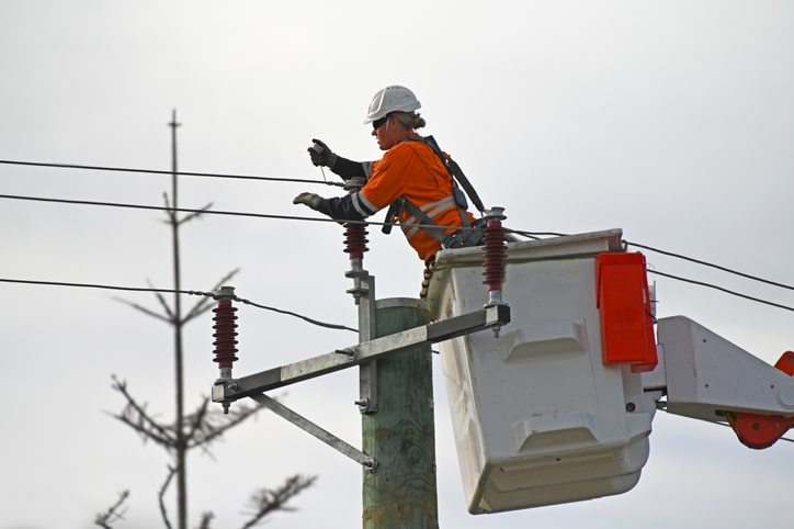 Female electricity worker fixing power line