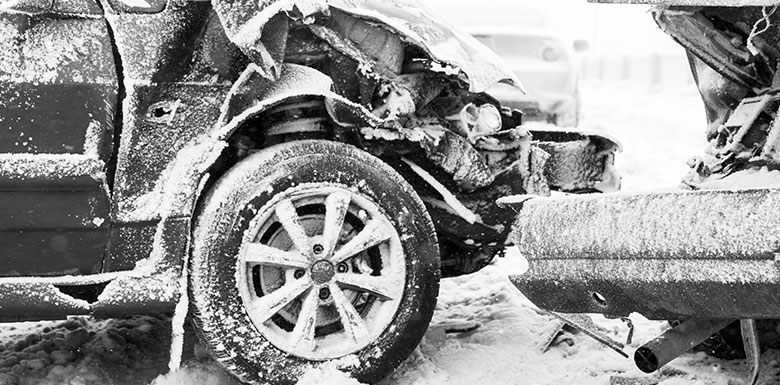Wrecked cars during a winter storm feature photo