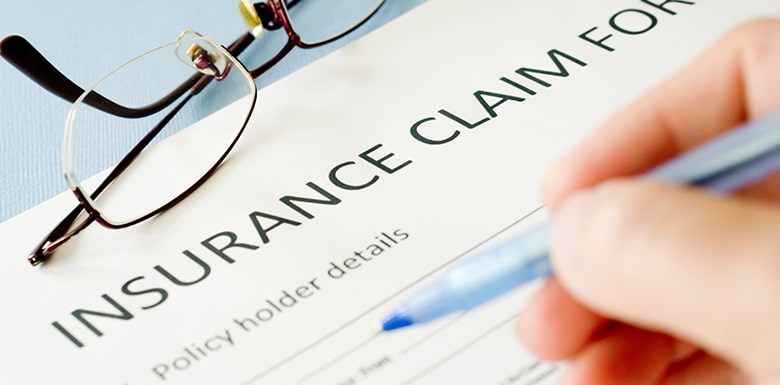 Filling out insurance claim form image