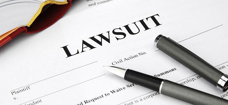 Pen sitting on lawsuit form
