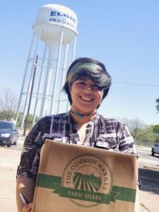 happy customer picking up her veggie box