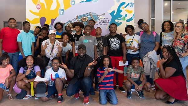 Mahiri Takai (c) and participants at AODI Youth programming