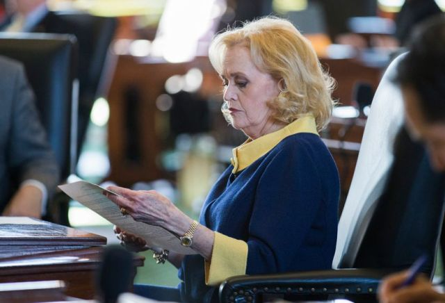 Senator Beverly Powell looked over documents at her desk on the second day of the 86th Texas Legislature on Wednesday, Jan. 9, 2019