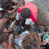 Children playing a game in Haiti