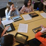 Students with tablets and sheet music