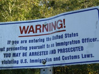 A sign at the international boundary between Canada and the United States in Point Roberts, Washington.