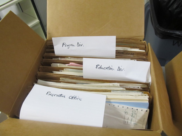 Records from different offices in a box.jpg