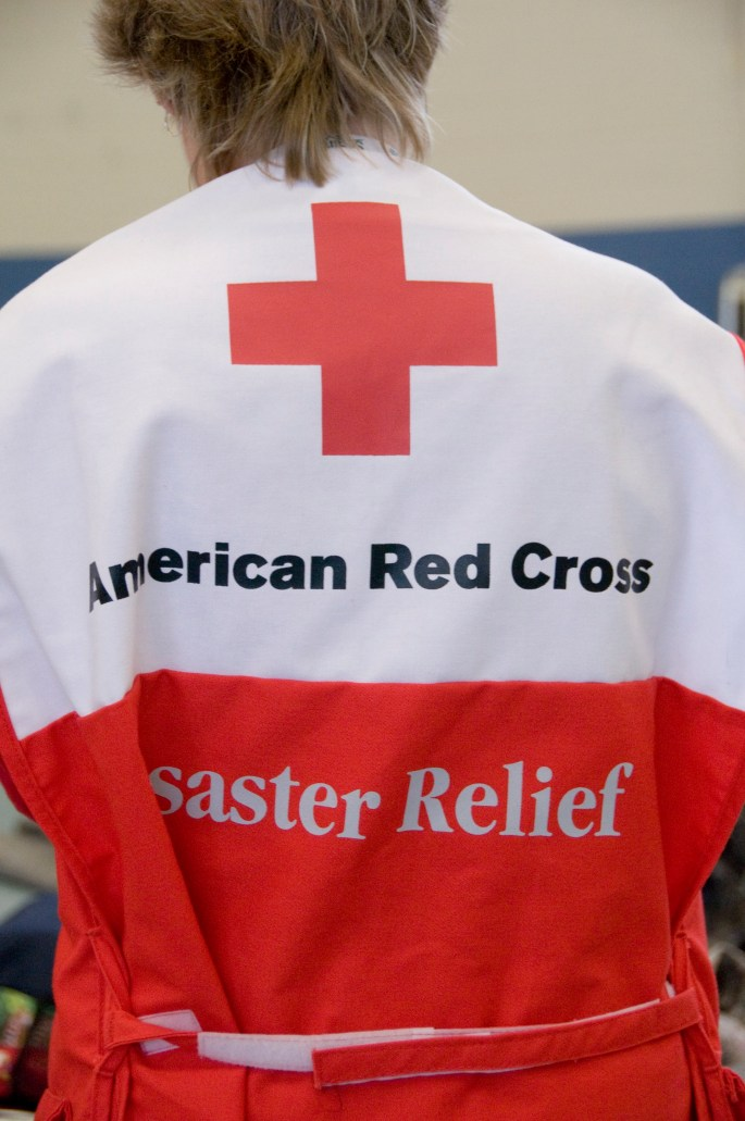 Image of aid worker with American Red Cross outfit.
