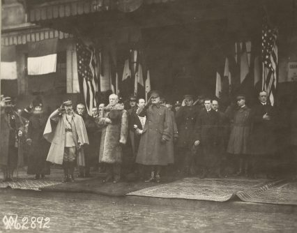 Image of President Woodrow Wilson standing at attention as the National Anthem is played upon his arrival at Chaumont, Haute Marne, France, 12/1918
