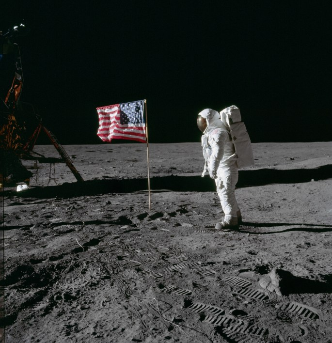 Edwin Aldrin looks at US flag planted on the moon