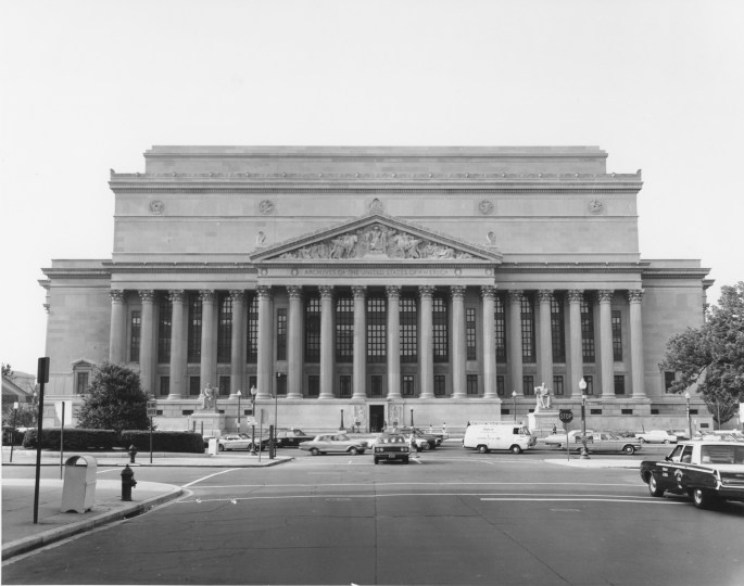 street view of the National Archives building showing traffic in front of it.