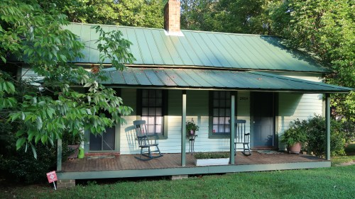 Single story houses like this were often shared with multiple families. Though, when they were lived in by a single family, one side would often be dedicated to sleeping quarters while the other would be a living area.