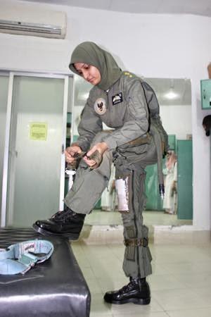 Female pilot wearing g-suit