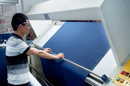 Fabric inspector inspecting fabrics