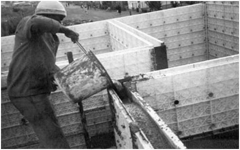 Low cost insulated walls for residential construction