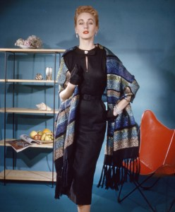 Model wearing a wool and Lurex stole made by Churchill Weavers, 1950s