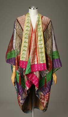 "Othello Coat by Ruth Funk, 2005. Silk, pieced sari fragments & tassels from India. Featured in the exhibition ""Embellished: A Celebration of Wearable Art,"" at the Ruth Funk Center for Textile Arts. Photo: Dominic Agostini"