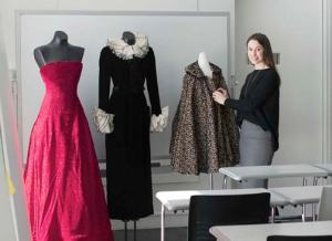 Curator and teacher Marcella Milio in her classroom with garments from the collection on display.