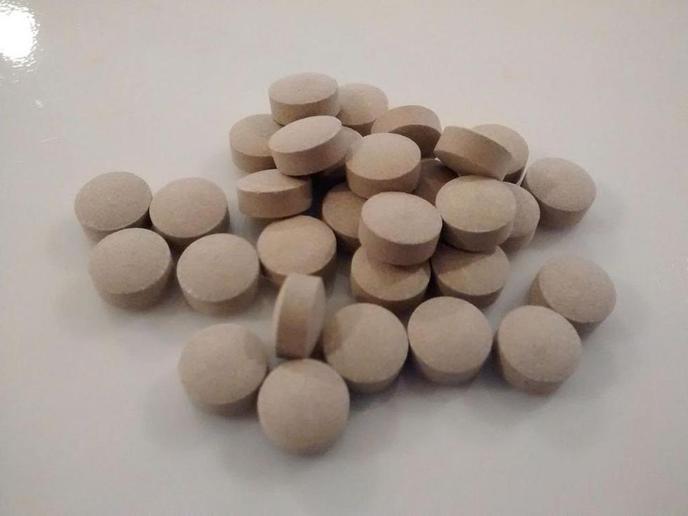 Таблетки серого цвета