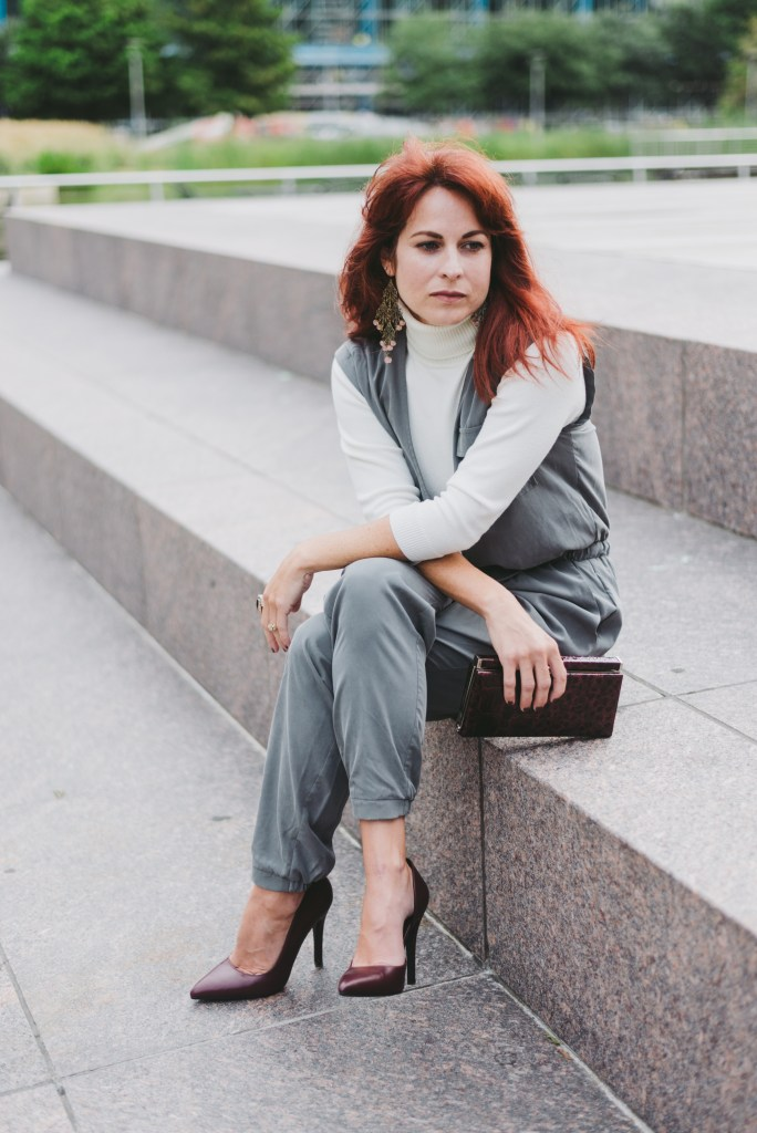 casual chic, jogger jumpsuit, silk jumpsuit, jumpsuit, turtleneck, statement earrings, discovery green, red hair inspiration, maroon accessories