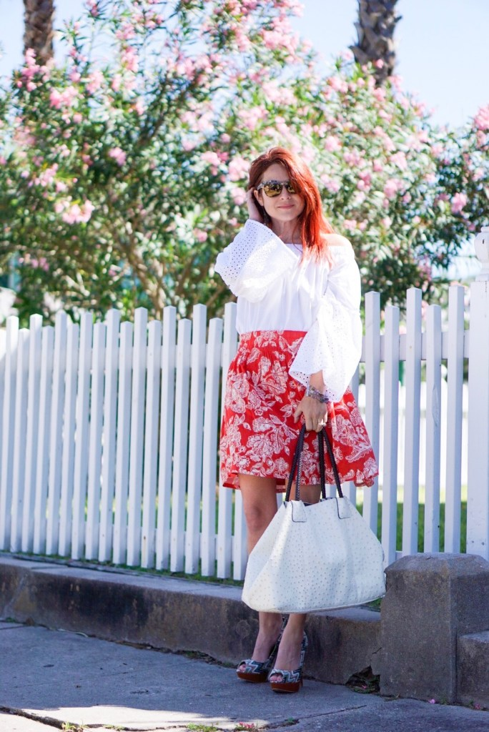 special needs, red floral skirt, high-wasited, white off the shoulder top, who what wear, chevron heels, white bag