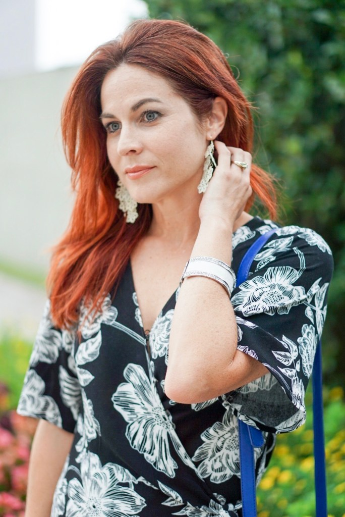wrap dress, black and white dress, red hair, chandelier earrings