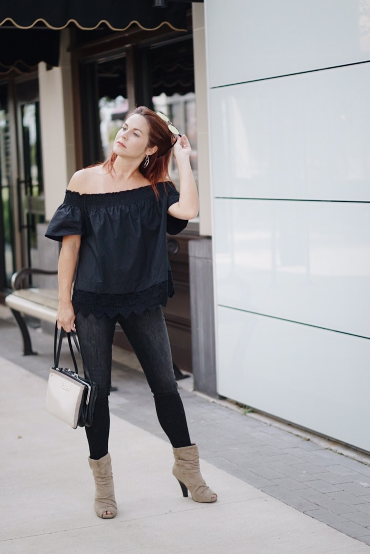 casual black top, lace details, off the shoulder, who what wear, black skinny jeans, suede bootie
