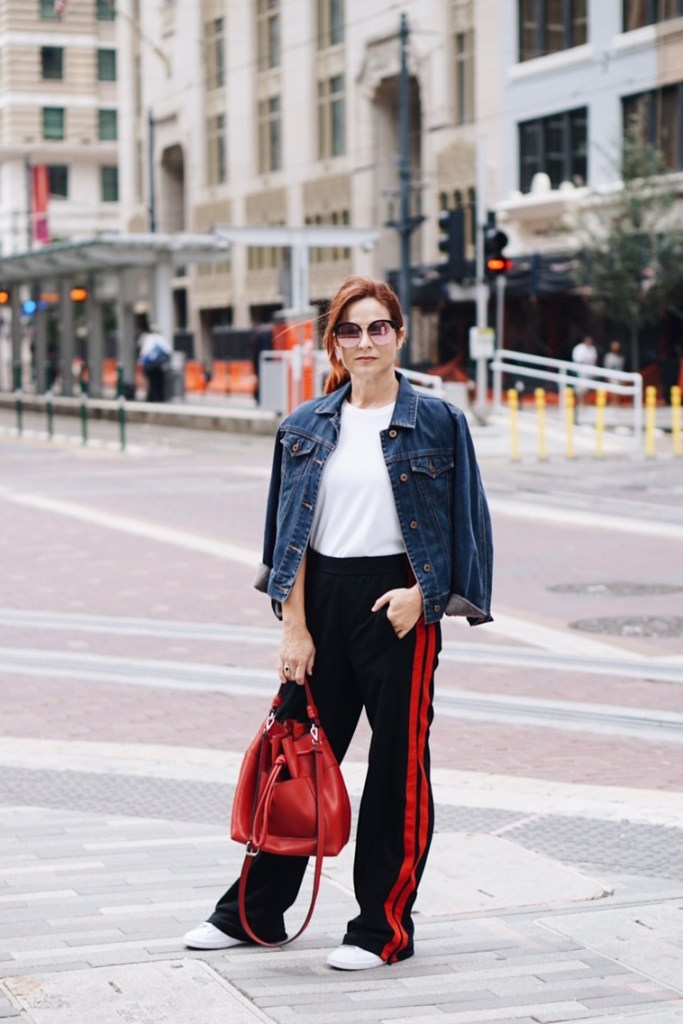 stylish track pants, athleisure style, cropped denim jacket, sneakers, street looks