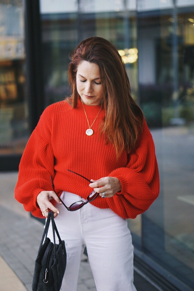 red sweaters, gold necklace, black sunglasses, high waisted pants, wool handbag