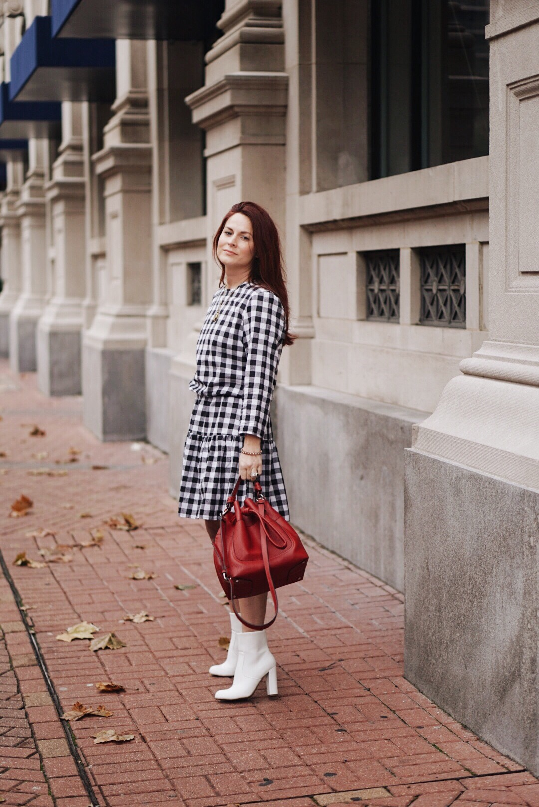 gingham, gingham dress, black and white dress, red bag, white boots