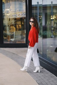 statement sleeves, red sweater, white booties, round sunglasses, white pants