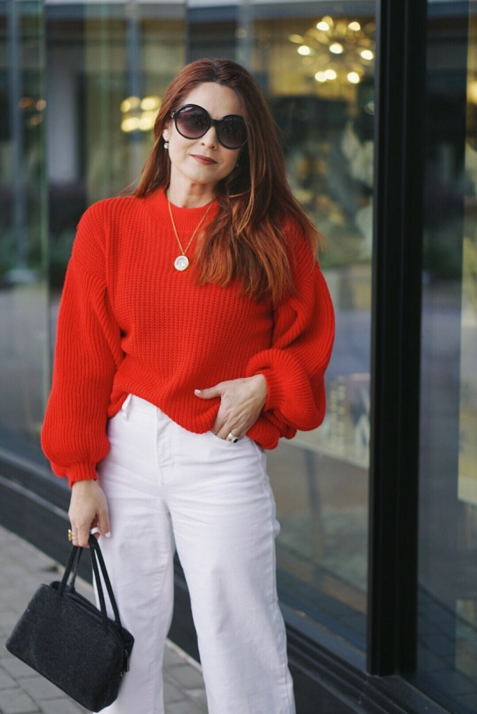 bubble sleeves, red sweater, valentines outfit inspiration, high-waisted, white denim, wool bag, black sunglasses