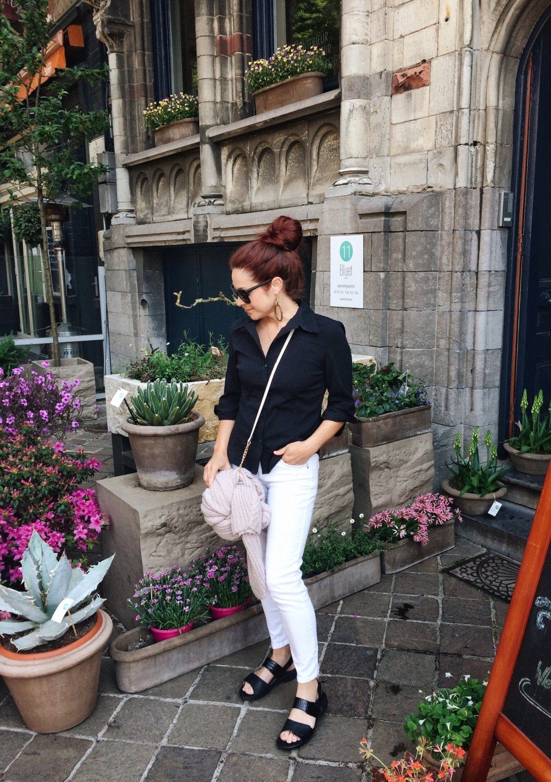 white jeans, black button up shirt outfits, cream cross-body, black sandals, revere shoes, cardigan, black sunglasses, Gent, floral stand