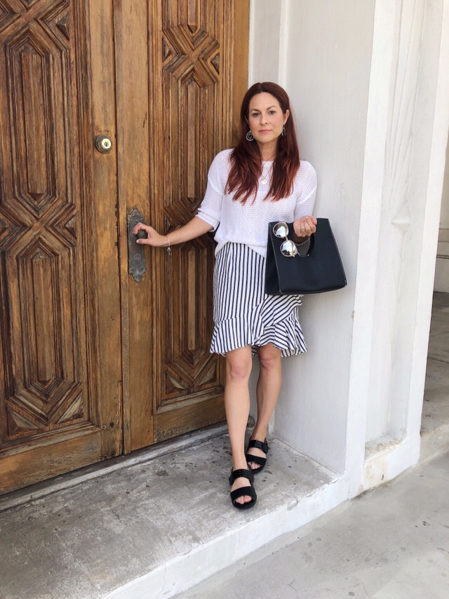 ruffle asymmetrical skirt, white sweater, revere shoes, cool doors, comfortable shoes, chic style, black handbags