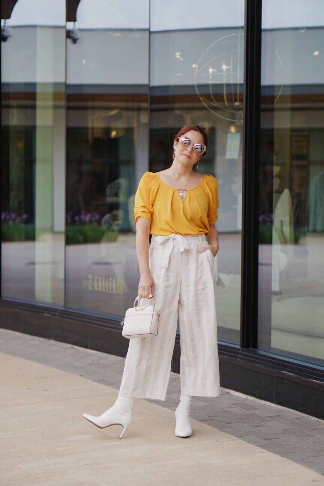 how to wear culottes, paper bag waist pants, white booties, target style, cream handbags, culotte outfits, cream sunglasses, yellow top outfits