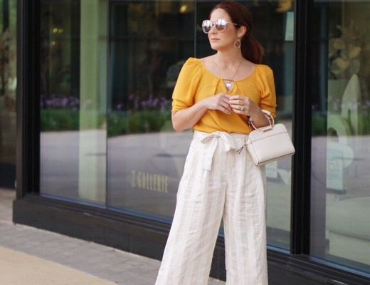 chic style, culottes, paper-bag waist, wrapped tie pants, mustard yellow outfits, yellow blouse, small cream handbags, white booties