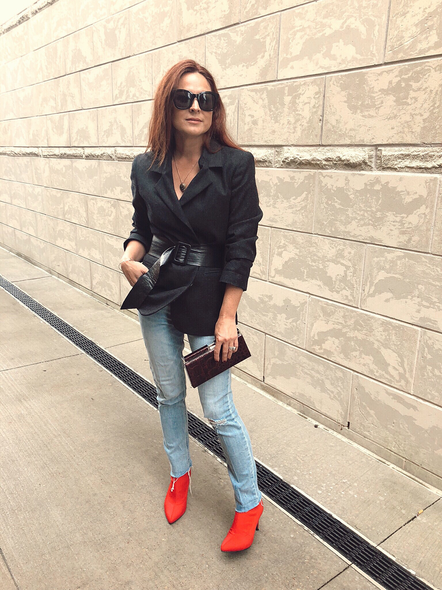 small clutches, red boots, how to wear a belt over outerwear