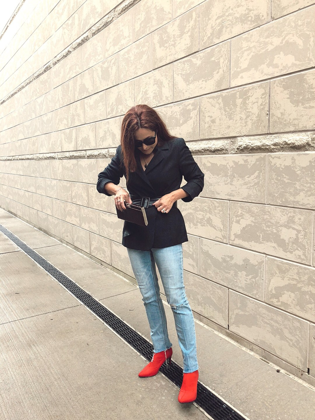 how to style a belt on a jacket, blazer outfit ideas, red sock booties, red boot outfits